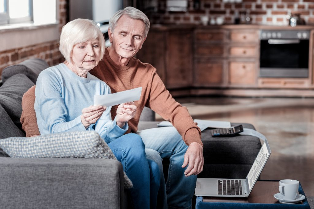 Older couple looking at social security check